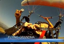 ...岁老太乘滑翔伞游天际 创世界纪录