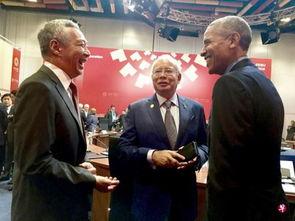 李显龙21日在秘鲁APEC会场感谢奥巴马在推动TPP方面展现的领导能...