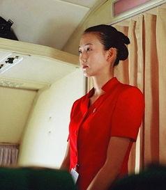 ...正恩亲自下令 朝鲜空姐换更短蓝色裙装 组图
