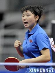 2月25日,朝鲜选手金仲在比赛中庆祝得分.当日,第49届世界乒乓球...