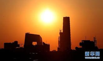 ...轮红日从北京的东方地平线冉冉升起.新华社记者 -旭日东升