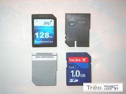 图中分别为SD卡、MMC卡和Treo 650、TT赠送的防尘卡片-领航智能 ...