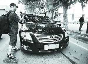 河南倔记者专拍公车私用 拍摄数千张 特权车