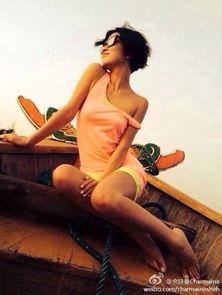 淘人体艺术越南妹-佘诗曼变越南妹 船头露美腿秀香肩