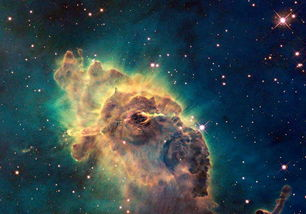 云动星沉-图为哈勃望远镜上的相机拍摄的船底座星云中的由炙热的气体和尘埃组...
